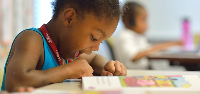 A student works on her reading skills as part of the Horizons summer program at UM.  Photo by Robert Jordan/Communications