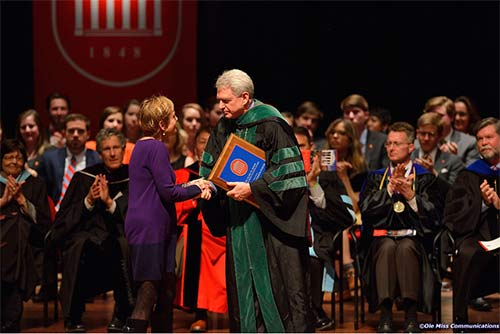 Dr. Fisher-Wirth receives the 2014 Elsie M. Hood Outstanding Teacher Award from Chancellor Jones.