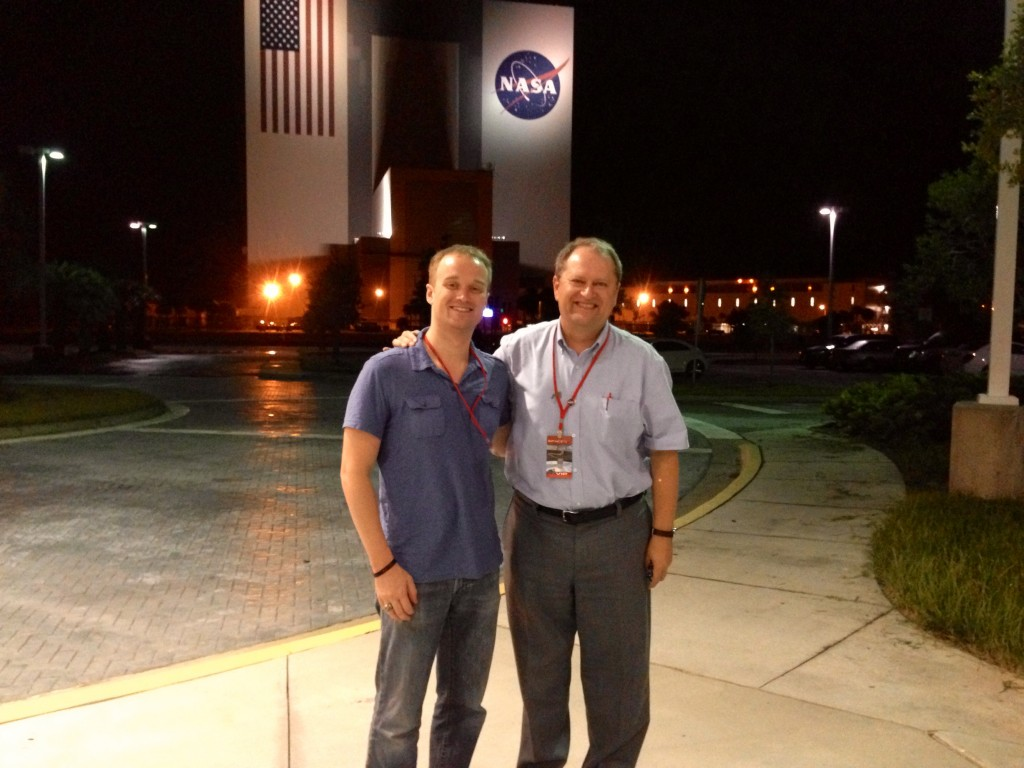 John Kiss, professor of biology, and  Josh Vandenbrink (post-doc on project) and jzk by the VAB waiting for the launch.