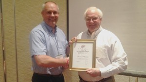 Robert Mantz (left), chair of the Physical and Analytical Electrochemistry Division of the Electrochemical Society, presents Charles Hussey with the society's Max Bredig Award in Molten Salt and Ionic Liquids. Courtesy photo.