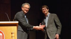 Dean Douglass Sullivan-Gonzalez presents Joe Bell with his Barksdale Award.