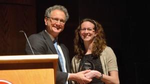 Dean Douglass Sullivan-Gonzalez presents Kate Lindsay with her Barksdale Award.