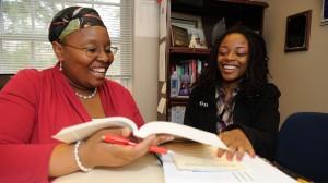 FASTrack academic adviser Jackie Certion (left) mentors a student in the program.