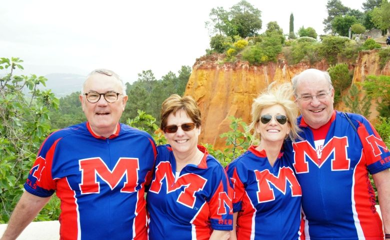 UM alumni Frances and Hume Bryant (right) and Bruce and Mary Betsy Bellande (left) of Oxford, Miss. enjoy a ten day cycling trip through the Provence region of France in 2014 while sporting their UM jerseys.