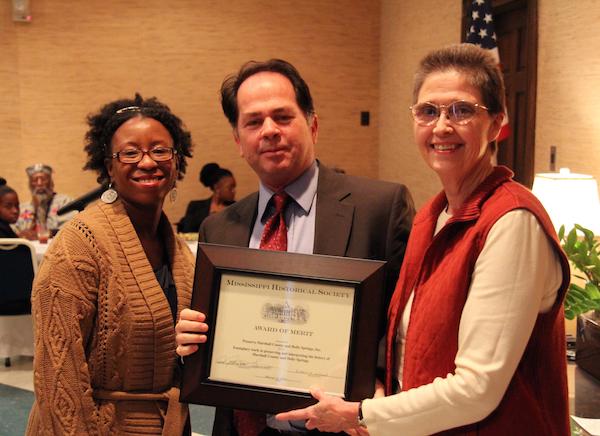 Professor Jodi Skipper (left) receiving the Mississippi Historical Society award.