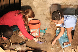 Martha Grace Mize and Kyara Williams excavate the basement of the Hughs house's slave quarters in Holly Springs, Miss., Saturday, April 11, 2015. (DM Photo | Zoe McDonald)