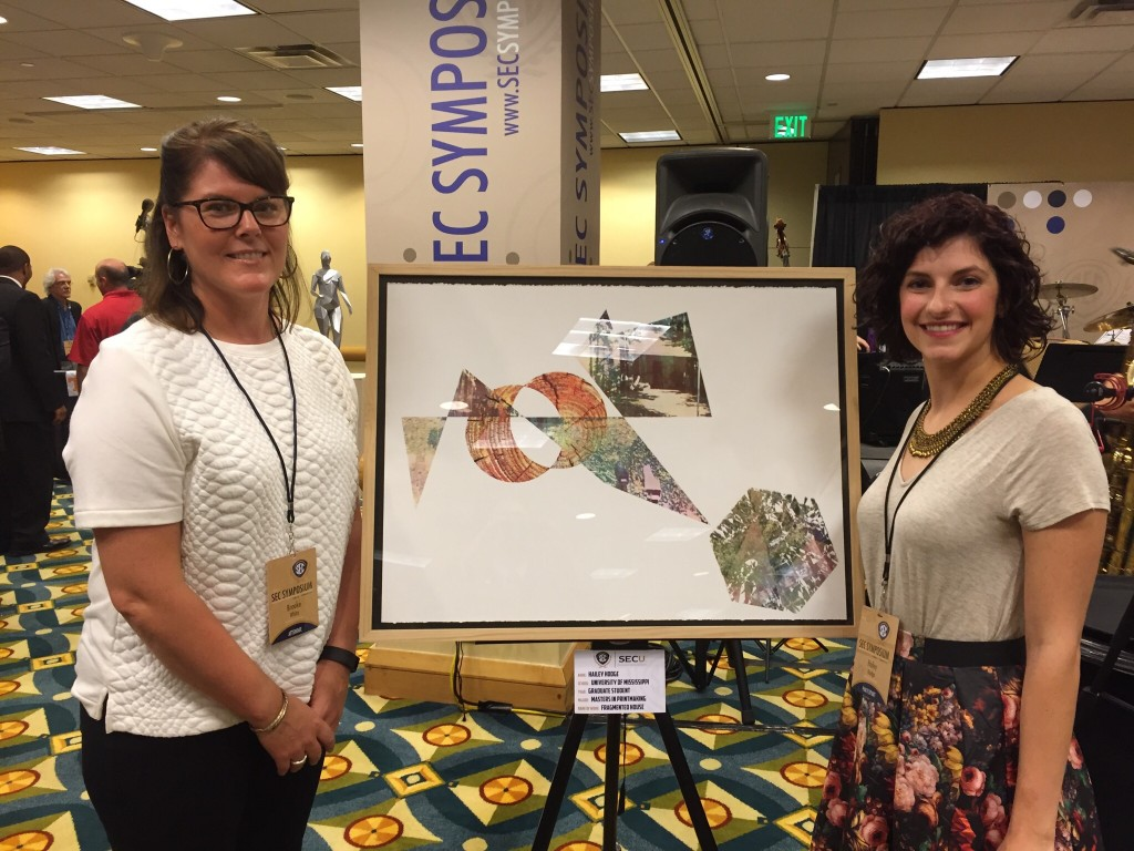 """Hailey Hodge (right) stands by her piece """"Fragmented House"""" with her professor, Brooke White."""