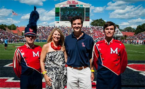immy and Amanda Carr awarded scholarships to Pride of the South band members Wes Brown (left) and Lee Easson (right).