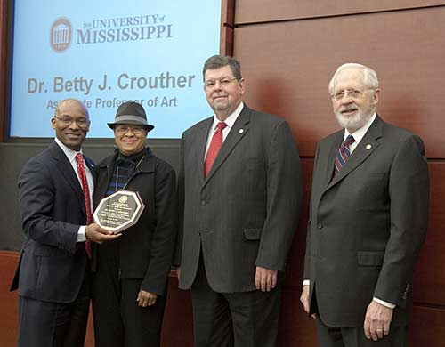 Trustee Shane Hooper, Dr. Betty J. Crouther, Associate Professor of Art, Dr. Morris Stocks, Provost, and Trustee Aubrey Patterson, President of the Board of Trustees.