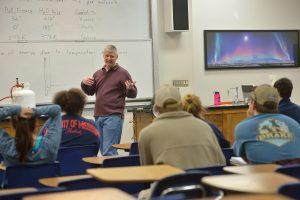 Breese Quinn teaches his physical science class.