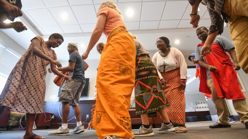 Neema Loy (left), a graduate teaching assistant from Tanzania, leads UM students in her Swahili language class in traditional Tarab dances. Photo by Robert Jordan/UM Communications