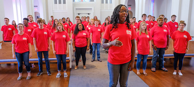 Stella Mbugua and the University of Mississippi Concert Singers take part in a worldwide performance for World Peace Day. The choir's performance in Paris-Yates Chapel was live-streamed on the internet. Photo by Robert Jordan/Ole Miss Communications