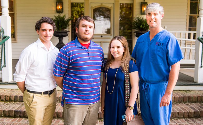 Dr. Preston Lee (right) of Oxford, Mississippi, greets recipients of the scholarships he and his wife, Elise Hayles Lee, established at the University of Mississippi. Students (from left) are Patrick Jenkins, a history major from Coldwater, Mississippi, who received the Lee Family Dentistry Scholarship in recognition of the Tate County community, where Lee has a clinic; Herman Story, a computer science major from Oxford, who received the Lisa Jacob Hayles Scholarship in honor of Lee's mother-in-law; and Avery Duke, a biology major from Oxford, who received the Karen Crocker Lee Scholarship in honor of Lee's mother who graduated from Ole Miss in 1973 with a bachelor's degree in education.