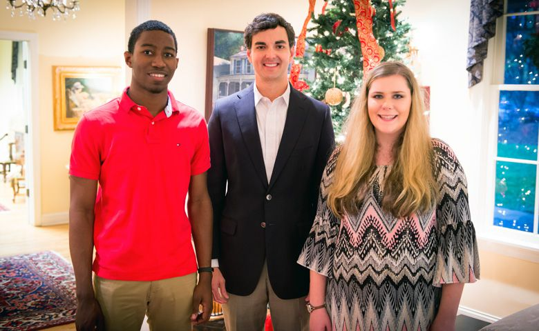 Alumnus Jimmy Carr (center) greets his 2016 scholarship recipients, Pride of the South Marching Band members James Vinson (left) and Taylor Bost (right) at Memory House.