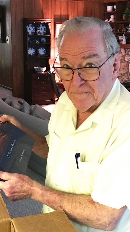 Dr. Creighton Wilson, at his home in Gainesville, Florida, opens a box of Ole Miss memorabilia sent to him from the UM Foundation in recognition of his many years of giving to the university.