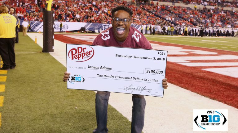 UM sophomore Jarrius Adams holds the $100,000 check he won during the Dr. Pepper Tuition Giveaway football throw-off in Indiana. Submitted photo