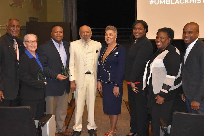 Honorees Gail Stratton (second from left) and Ryan Upshaw (third from left) with Don Cole, associate professor of mathematics, James and Judith Meredith, Shawnboda Mead, Katrina Caldwell, and Brian Foster. Photo by Robert Jordan/UM Communications