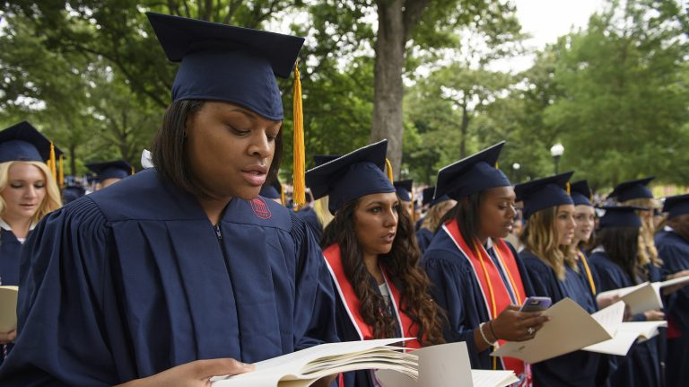 Graduates sing the university's alma mater during the morning convocation from Commencement 2016. Photo by Thomas Graning/UM Communications