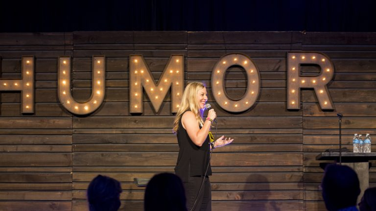 Alumna Kendall Ketchum performs her comedy routine at KAABOO's comedy club in Del Mar, California. Submitted photo