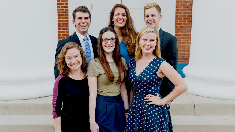The university's inaugural Stamps Scholars recently gathered to re-create their class photo from four years ago. They are (front, from left) Madeleine Achgill, Kate Prendergrast and Eloise Tyner, and (back, from left) Dylan Ritter, Kathryn James and Ben Branson. Photo by Bill Dabney