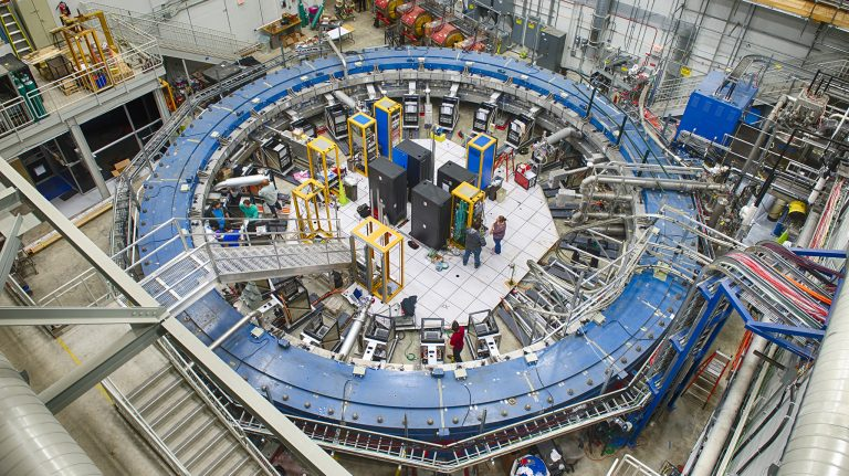Scientists install equipment and prepare the Muon g-2 ring, a 50-foot electromagnet, to take muons at the Fermi National Accelerator Laboratory. The work is part of an experiment to determine whether undetected elementary particles exist or if the Standard Model of Physics is complete. Photo courtesy Fermilab