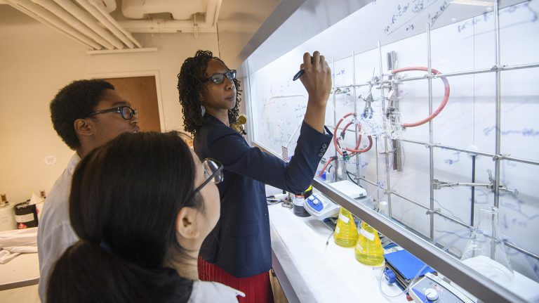 Davita Watkins (right), assistant professor of chemistry and biochemistry, works with students Briana Simms and Duong Ngo in her lab in Coulter Hall. Photo by Thomas Graning/Ole Miss Communications
