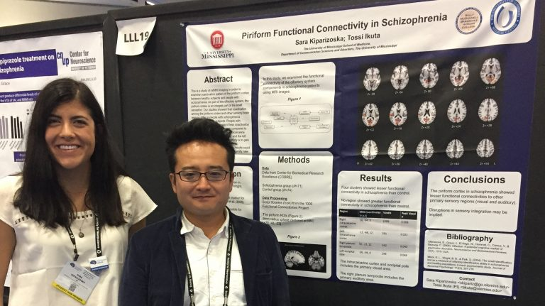Sara Kiparizoska (left), a 2016 UM biochemistry graduate, and Tossi Ikuta, assistant professor of communication sciences and disorders, show off a poster detailing their research at the National Society for Neuroscience Convention in San Diego. Submitted photo