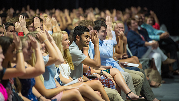 Freshmen throw up the Landshark sign during the University of Mississippi's Fall Convocation. The university enrolled 3,697 freshmen this fall and 23,780 students overall. Photo by Kevin Bain/Ole Miss Communications