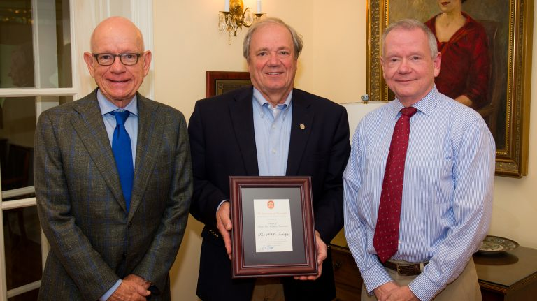 UM Foundation President and CEO Wendell Weakley (center) presents Mike Overstreet (left) and Larry Overstreet with a plaque, recognizing their mother's generous estate gift to the Ole Miss Opportunity Scholarship program. UM Photo by Bill Dabney