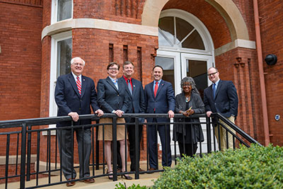Charles L. Hussey (left), associate dean for research and graduate education, and Donald L. Dyer (third from left), associate dean for faculty and academic affairs, joined Dean Lee M. Cohen (third from right), Associate Deans Jan Murray (second from right) and Holly Reynolds (second from left), and Assistant Dean Stephen Monroe this year.