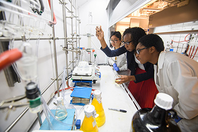 Dr. Davita Watkins (center) in her lab with students Duong Ngo and Briana Simms