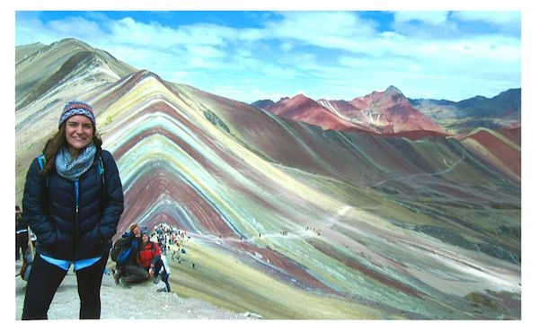 Abby Bruce stands at 17,060 feet in front of Montaña de Siete Colores in Cusco, Peru.