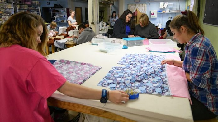 UM theatre arts students in Donna Buckley's costume design class sew dresses that will be distributed to young girls in need through St. Peter's Episcopal Church's Little Dresses Ministry. Photo by Robert Jordan/Ole Miss Communications