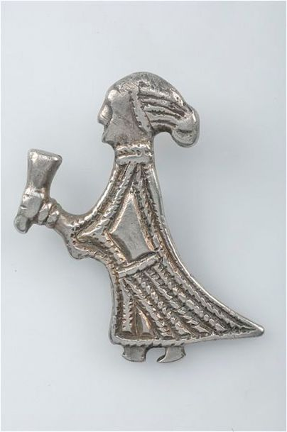 This small silver pendant, which is around an inch high, found in Sweden, is interpreted as a Valkyrie offering a cup of mead to welcome a fallen warrior to Valhalla, the hall of the slain, according to Norse mythology. Submitted photo by Creative Commons
