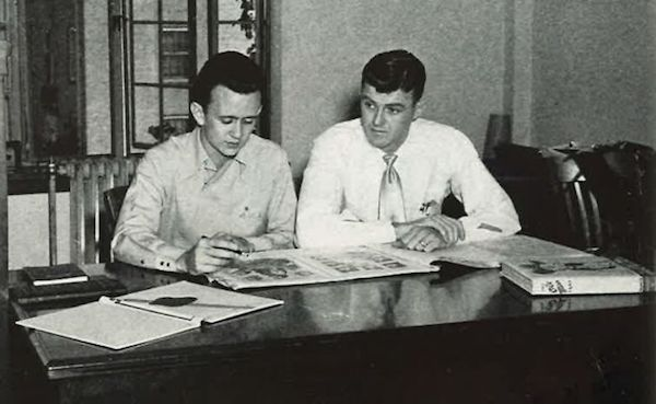 As Ole Miss yearbook editor, Buddy Shaw (left) and Jimmy Parkin, yearbook business manager, review the layout for the 1950 edition.