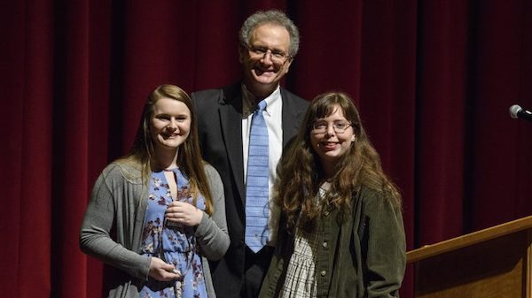 Gabrielle Schust (left) and Bethany Fitts are congratulated by Dean Douglass Sullivan-González after receiving Barksdale Awards during the Honors College's annual spring convocation. Photo by Thomas Graning/Ole Miss Communications