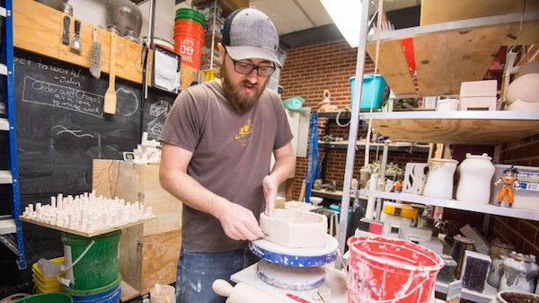 Nicholas Meyer creates ceramics in his art studio. His pieces are be on display through March 30 at Southside Gallery in the exhibit 'Unknowns Illuminated.' Photo by Kevin Bain/Ole Miss Communications