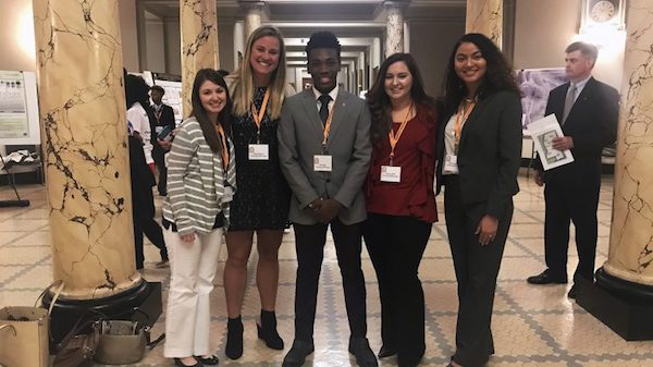 University of Mississippi students (left to right) Madison Savoy, Abigail Garrett, Cellas Hayes, Lindsey Miller and Brittany Brown present their undergraduate research during Posters in the Rotunda March 20 at the state Capitol. Photo by Shea Stewart/University Communications