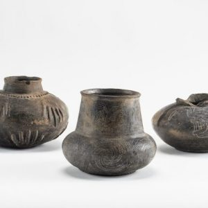 These ceramic objects from UM's Davies collection, dating back to 1400, were used by Native Americans in the Mississippi Valley. The objects are on display at The Historic New Orleans Collection. Photo by Robert Jordan/Ole Miss Communications