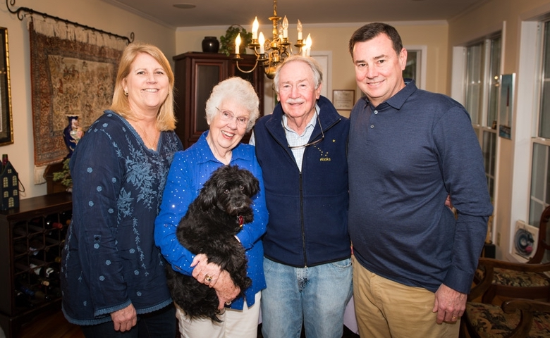 Lee Anne (left) and Bill Fry (right) visit with Sandy (holding Collette) and Vaughn Grisham in their Oxford, Mississippi, home.