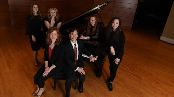 Nancy Maria Balach, associate professor of music and founder of Living Music Resource, and Bruce Levingston, the Chancellor's Artist-in-Residence of the Sally McDonnell Barksdale Honors College, (seated, center) work with four of Balach's top students as they prepare to travel to New York City where they will produce a special 'LMR Live' program. The students are (standing, from left) Lacey Hindman, Melanie Culhane, Ava Street and Jocelyn Sanabria. Photo by Kevin Bain/Ole Miss Communications