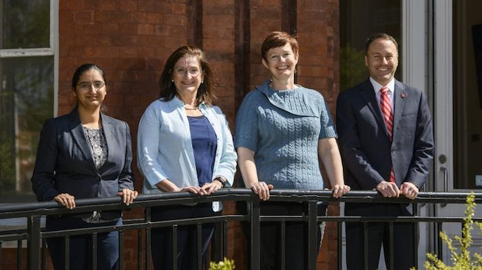 Dean Lee Cohen (right), congratulates College of Liberal Arts faculty (from left), Nidhi Vij Mali, Irene Kaufmann and Molly Prasco-Pranger for their outstanding teacher awards. Photo by Thomas Graning/ Communications