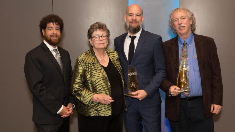 Jimmy Thomas, Ann Abadie, Odie Lindsey and Ted Ownby accept the Special Achievement Award on behalf of the UM Center for the Study of Southern Culture at the MIAL banquet.