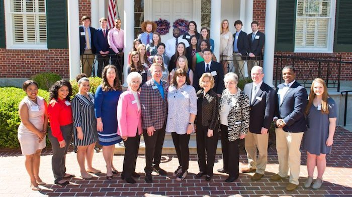 The Kelly Gene Cook Charitable Foundation board and Executive Director Katy Pacelli (front, fourth from left) joins Chancellor Jeff Vitter and Sharon Vitter for a spring luncheon to celebrate the Cook and Mikell Scholars. JoAnn Mikell (front, in pink), secretary; Carolyn Bost (front, fifth from right), director; Deborah Rochelle (front, fourth from right), chair; and Ron Page (front, third from right), treasurer; are surrounded by the undergraduate and graduate scholars at Ole Miss.