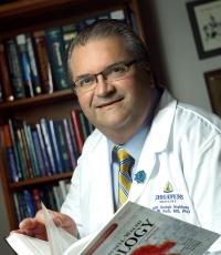 Dr. Alan W. Partin