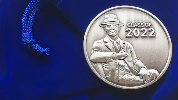 The Class of 2022's commemorative coin depicts William Faulkner.