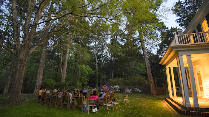 UM students and faculty participate in a discussion of slavery, segregation and racism on the grounds of Rowan Oak before staying overnight in the old kitchen, behind the house. Photo by Thomas Graning/