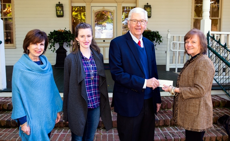 Karan (left) and Eric Clark of Oxford, present a check to Sandra Guest, vice president of the UM Foundation. The gift adds a $10,000 contribution to the existing John S. and Mamie Craft Clark Memorial Scholarship Endowment Fund at the University of Mississippi. Joining them is the 2018 Clark Scholar, Margaret Jordan, a freshman mathematics major from Pearl.