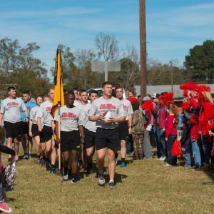 Ole Miss ROTC cadets reach the Calhoun City town square and are welcomed by cheering fans during last year's Egg Bowl Run. This year's run, which will bring the ceremonial game ball for the annual Egg Bowl game to Oxford, will be Monday (Nov. 19). Photo by Kevin Bain