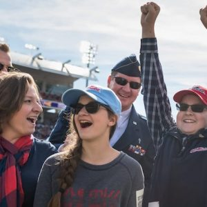 Ole Miss Wish Kid Benjamin Clark celebrates with his family when he hears that he is going to Disney World courtesy of the nonprofit Walkers for Warriors and the Student Veterans Association. Photo by Megan Wolfe